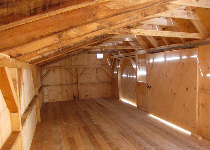 ... Custom Saltbox   Exterior 12x32 Three Sled Shed Interior