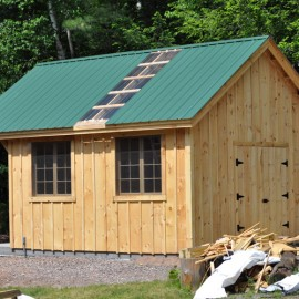 16x20 Vermont Cottage C with double barn doors and clear poly roof panel.