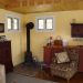 16x20-vermont-cottage-interior-living-room-woodstove-small-house-kit