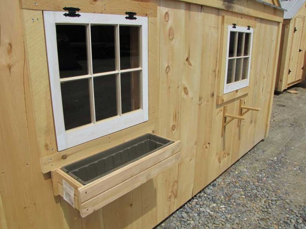 The difference is clear: A Flower Box for the window of your cabin or cottage adds a lot.
