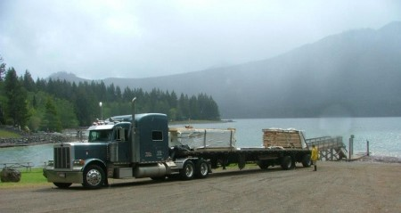 delivery floated out to an island, wood shed kits