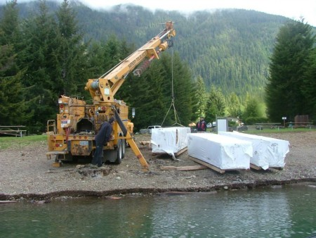 Delivery of a pre-cut kit using a crane.