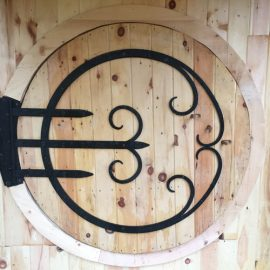 Round door with custom hinge