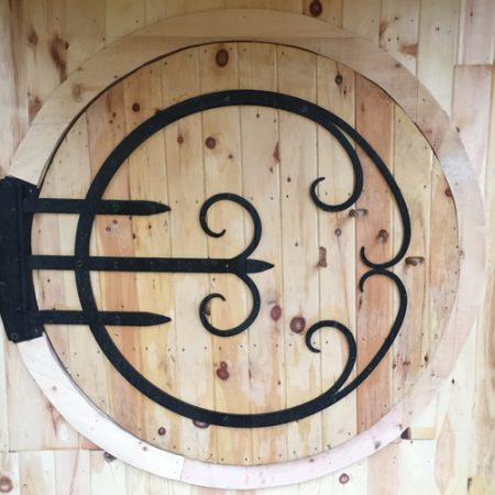 Round door with custom hinge